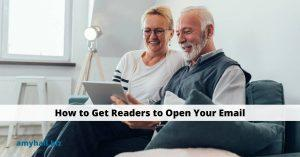 How to Get Readers to Open Your Email couple sitting on couch reading email on a tablet